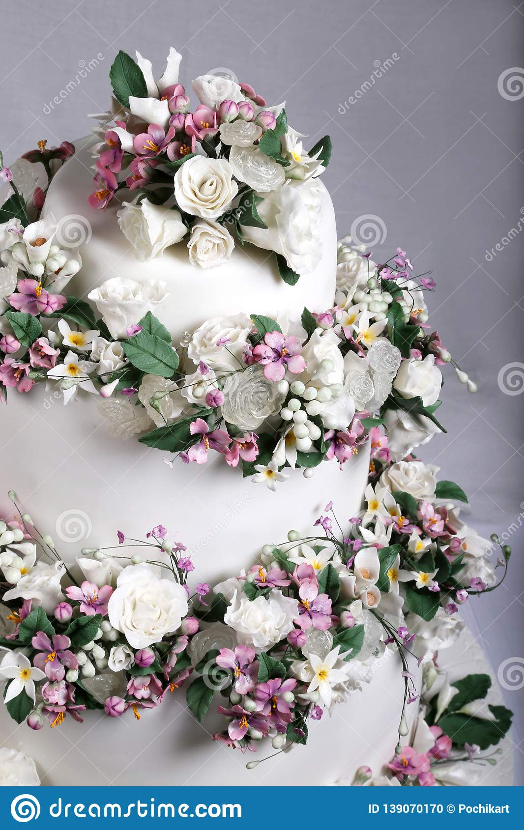 Close up image of Wedding Cake Topper with Sugar Flowers