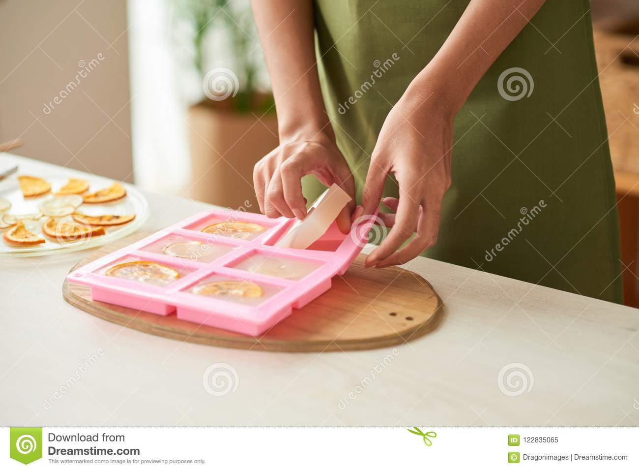 Close-up image of woman taking homemade soap out of silicone mold