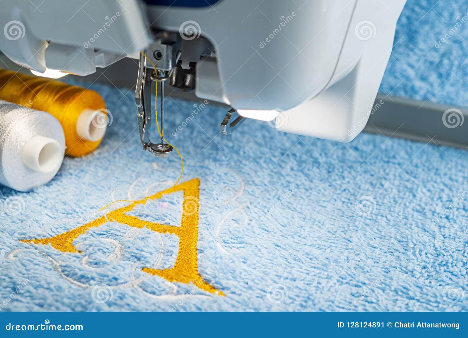 Embroidery Machine And Monogram Logo Design Stock Image - Image of