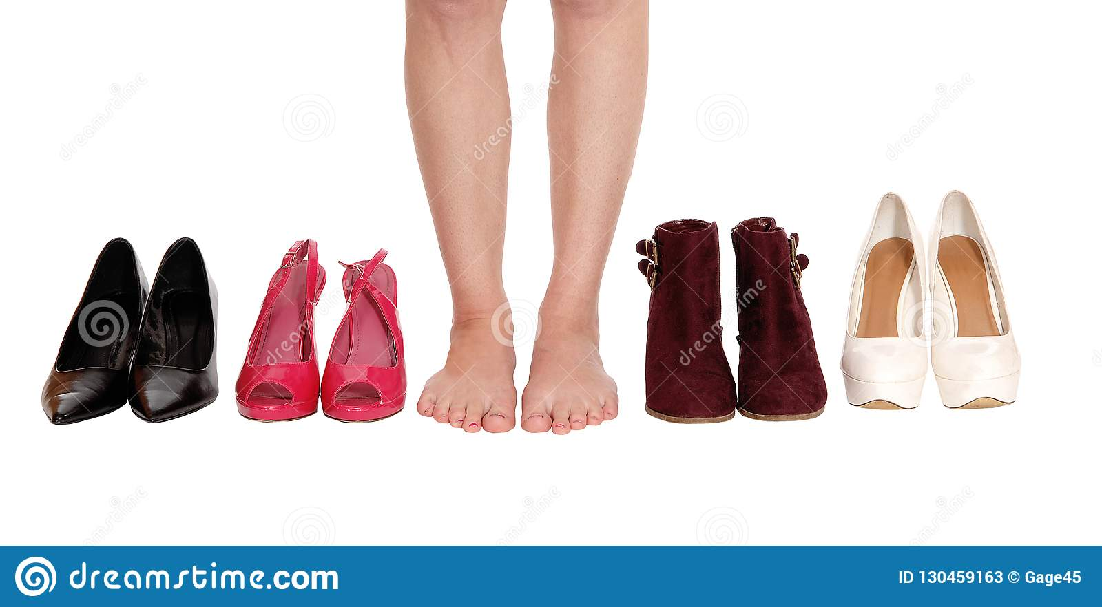 1a416b3fdf A close up image of a young woman legs standing between four pair of shoe  and high heels