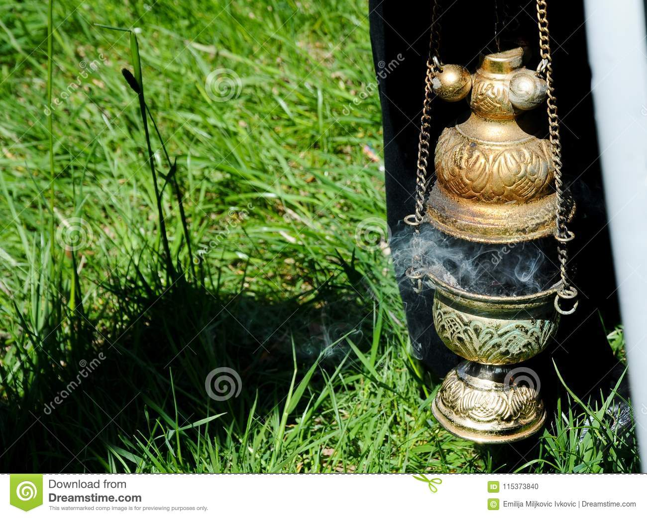 incense holder for traditional orthodox ritual, with smoke of burning incense