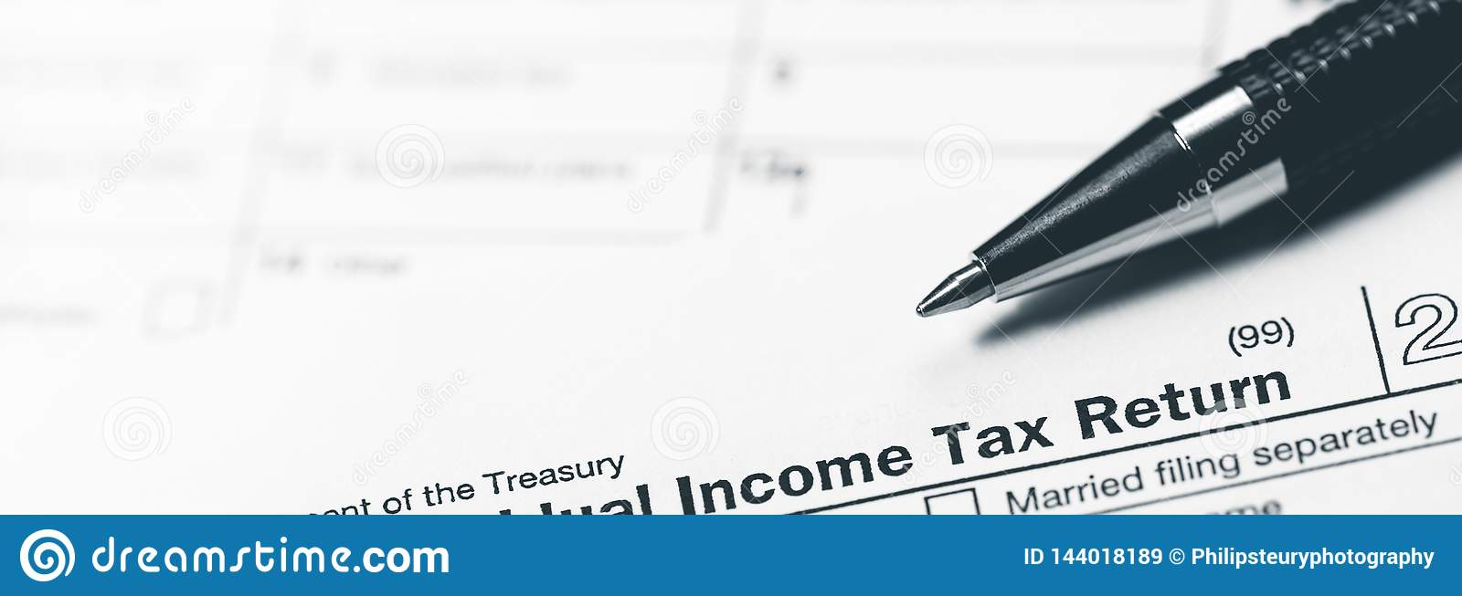 Income Tax Return Form With Pen