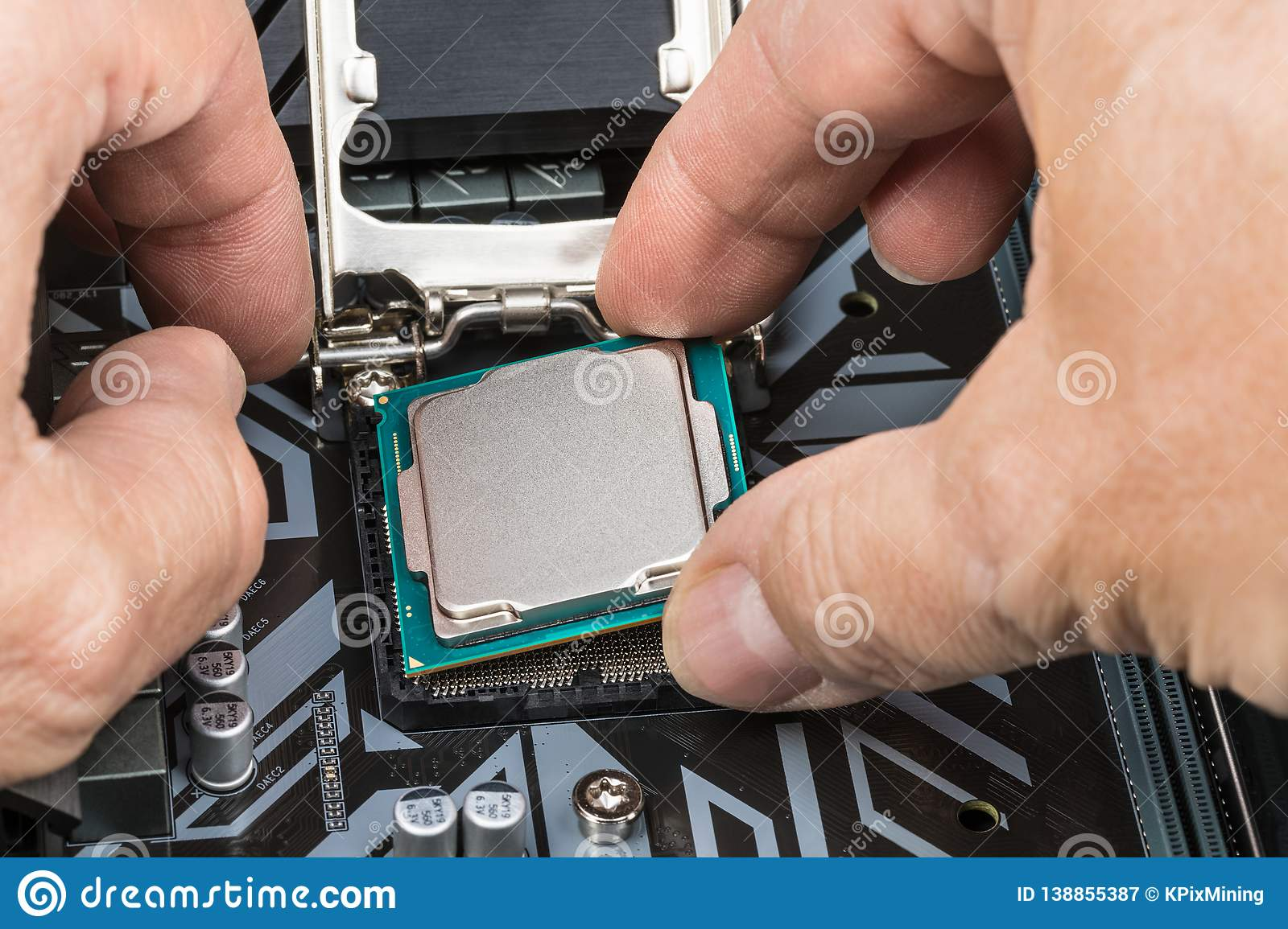 Detail of expert hands at processor replacement