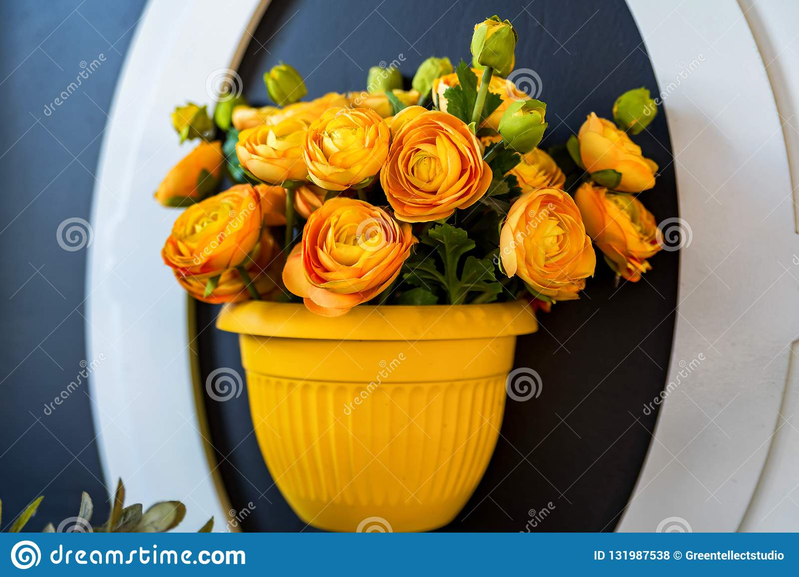 Artificial Orange Rose Flowers In Vase On Wall Stock Photo ...