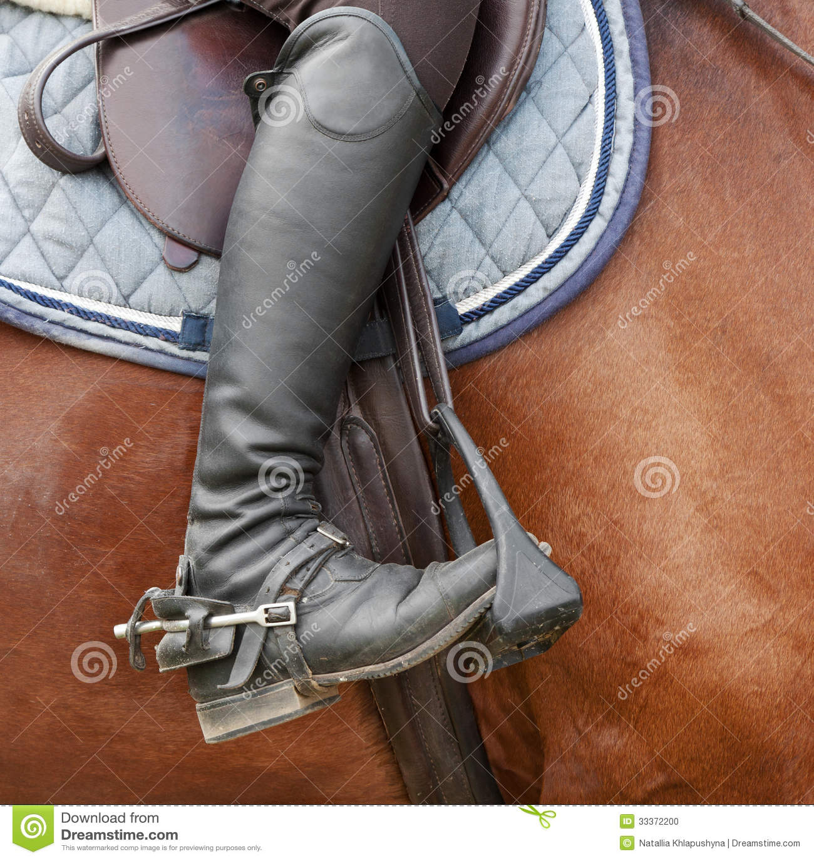 Close Up Of Jockey Riding Boot Saddle And Stirrup Stock