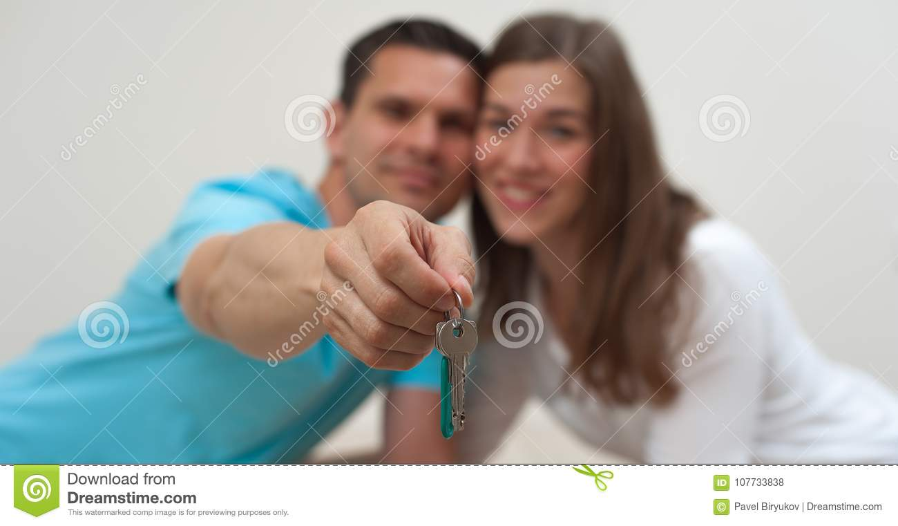 Close-up of the keys to an apartment in the hands
