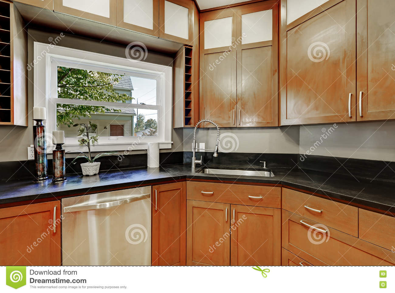 Modern kitchen counter close up - Close Up Of Kitchen Cabinets Black Counter Top Small Window Stock Photo