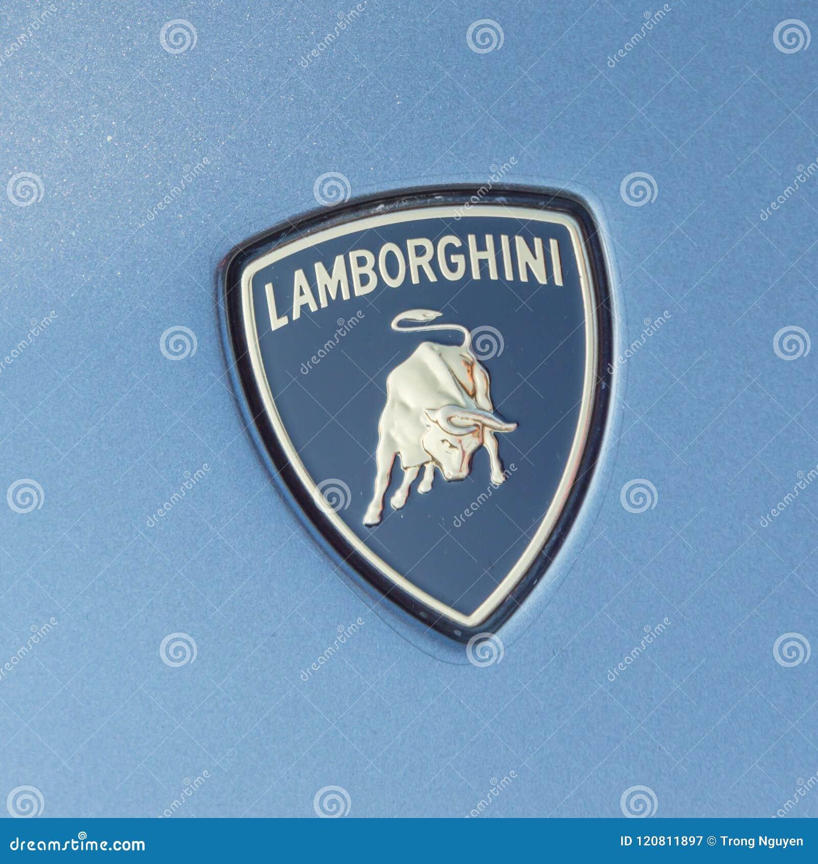 close up lamborghini logo on grey aventador editorial photography