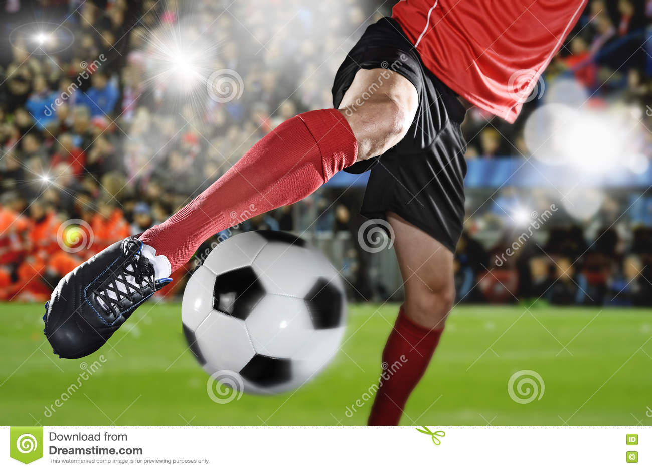 close up of a soccer ball and a feet of a soccer player 2 royalty