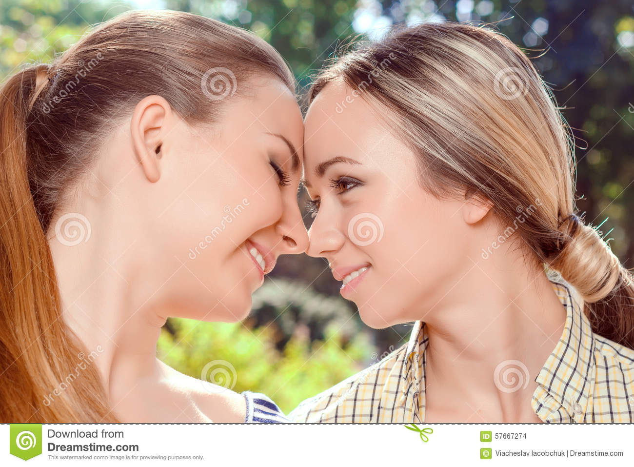 Lesbian love. Close up portrait of two young pretty lesbian women ...