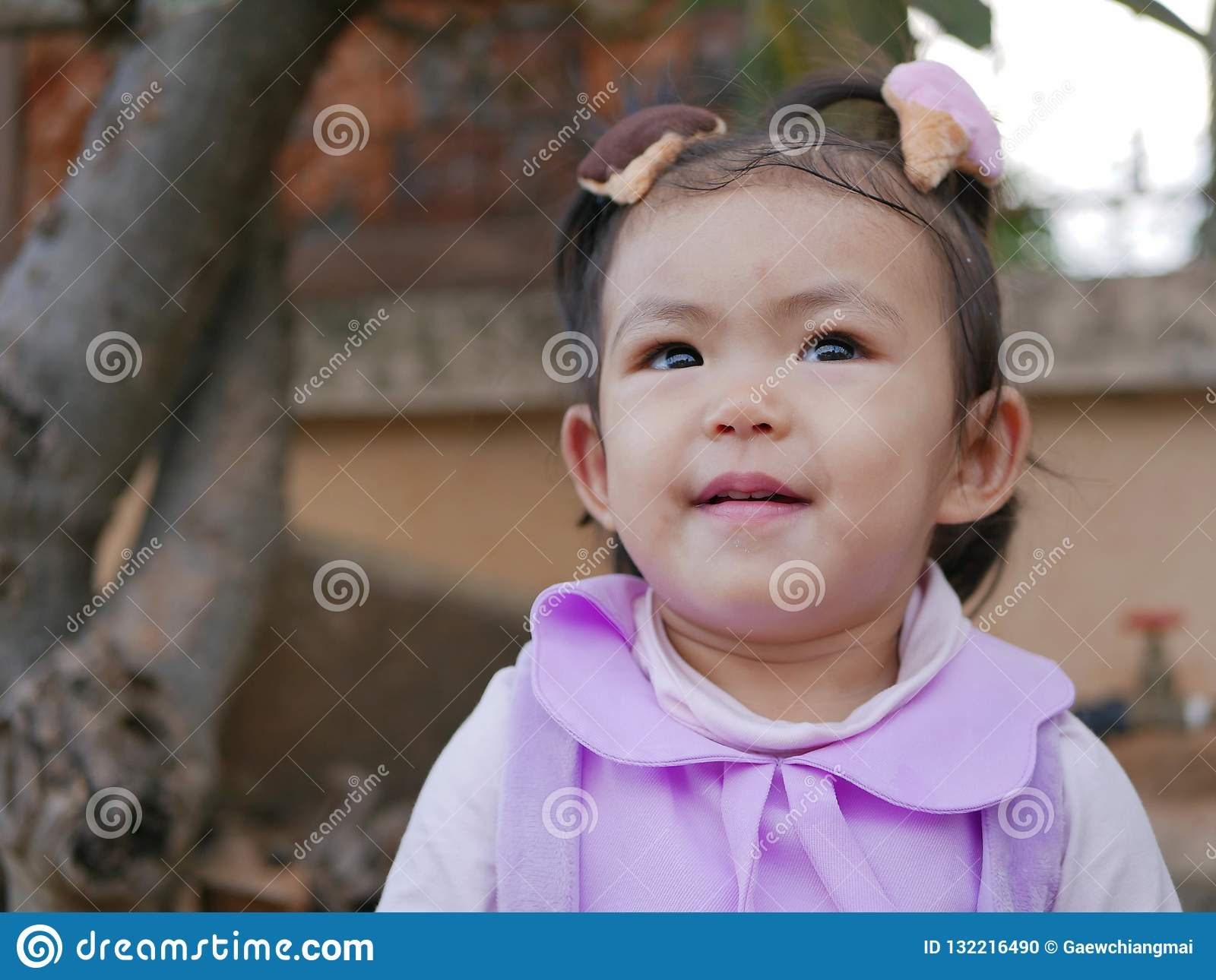 Close up of little Asian baby girl smiling and being happy
