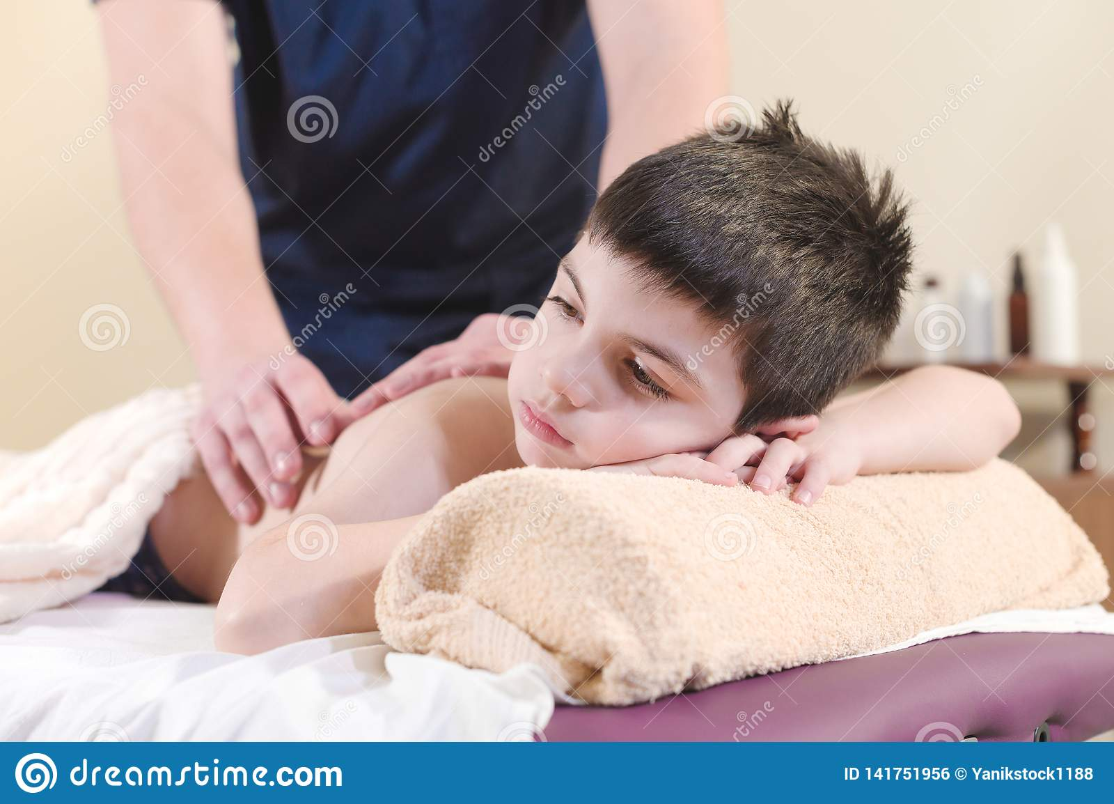 Close Up A Little Boy Relaxes From A Therapeutic Massage ...