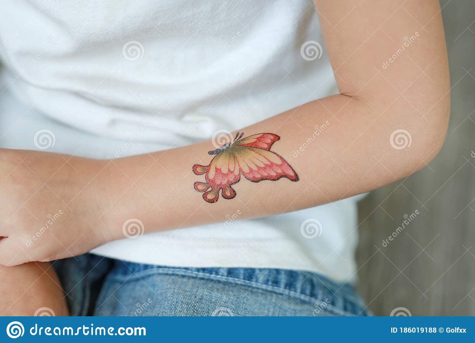Close Up Little Child Girl With Butterfly Tattoo Sticker On Hand Dress Up Tattoos Stock Photo Image Of Attractive Animal 186019188