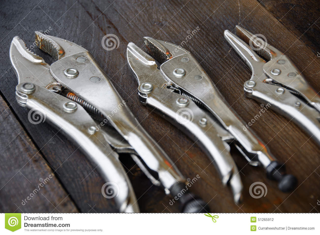 close up locking pliers on wooden background hand tools in work shop royalty free stock photo. Black Bedroom Furniture Sets. Home Design Ideas