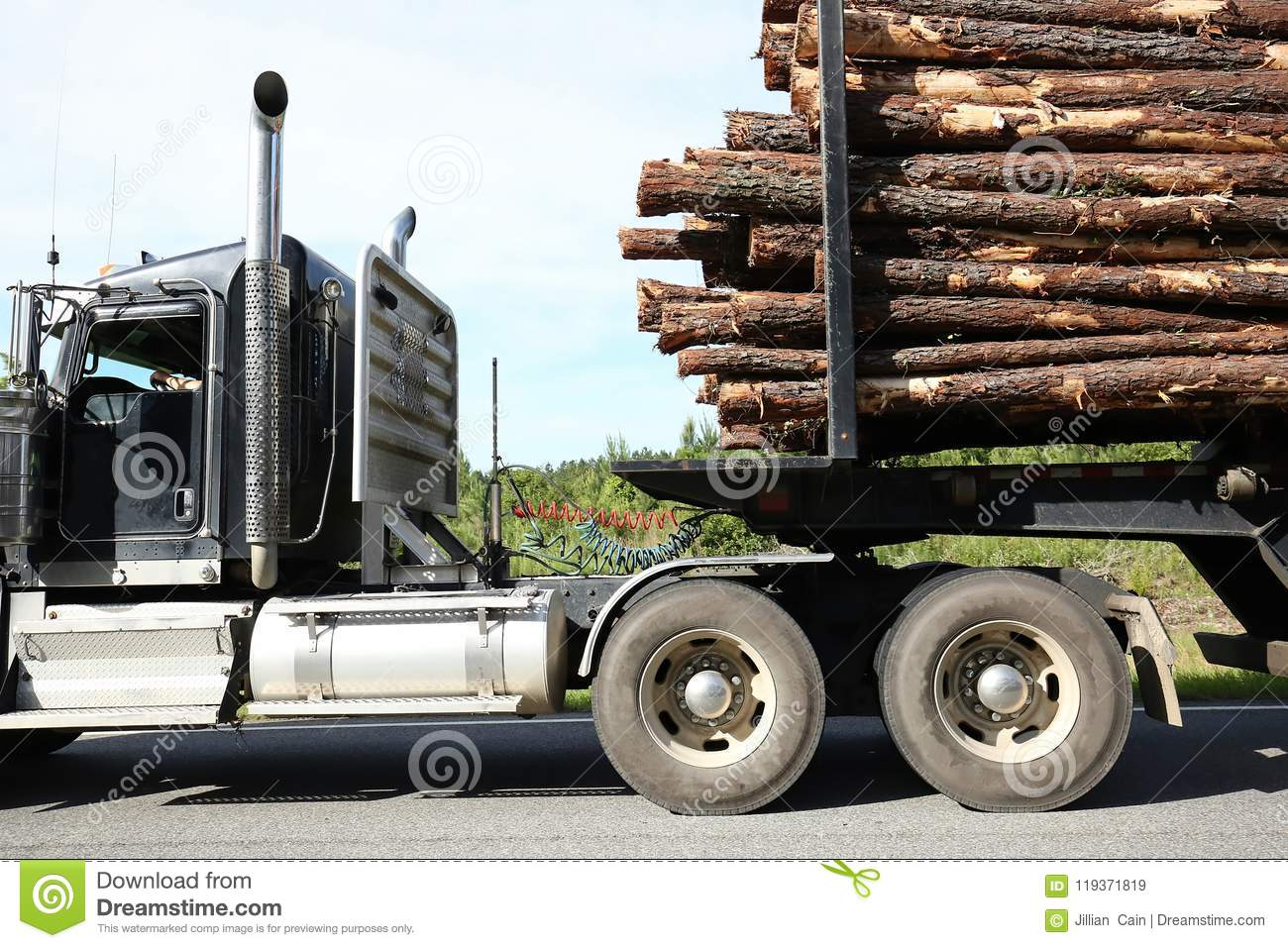 Close Up Of A Logging Truck Carrying A Full Load Of Logs Stock Image