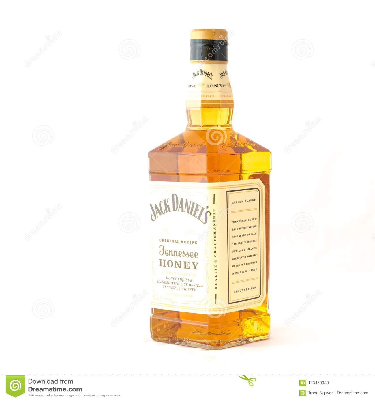 close up luxury bottle of jack daniels tennessee honey isolated