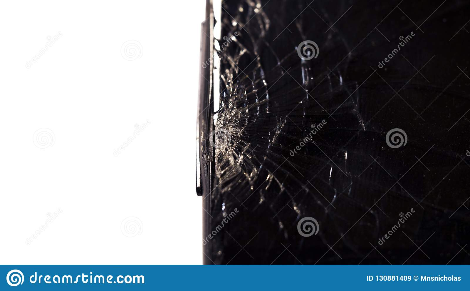Close-up macro of broken dark glass. Elements of smartphone, screen, hammer blow, dropped smartphone