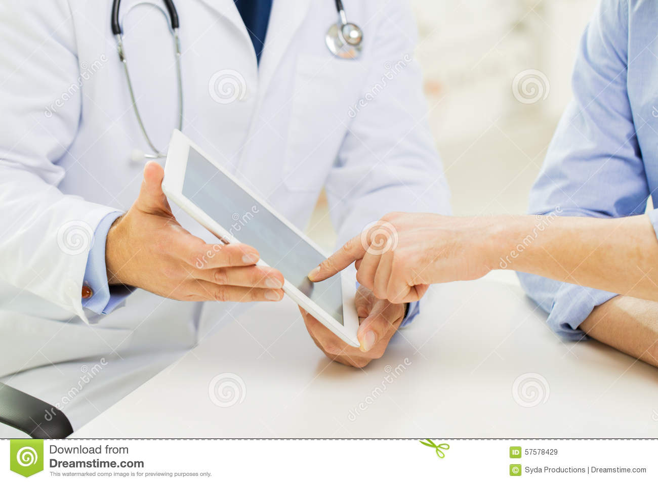 Close up of male doctor and patient with tablet pc