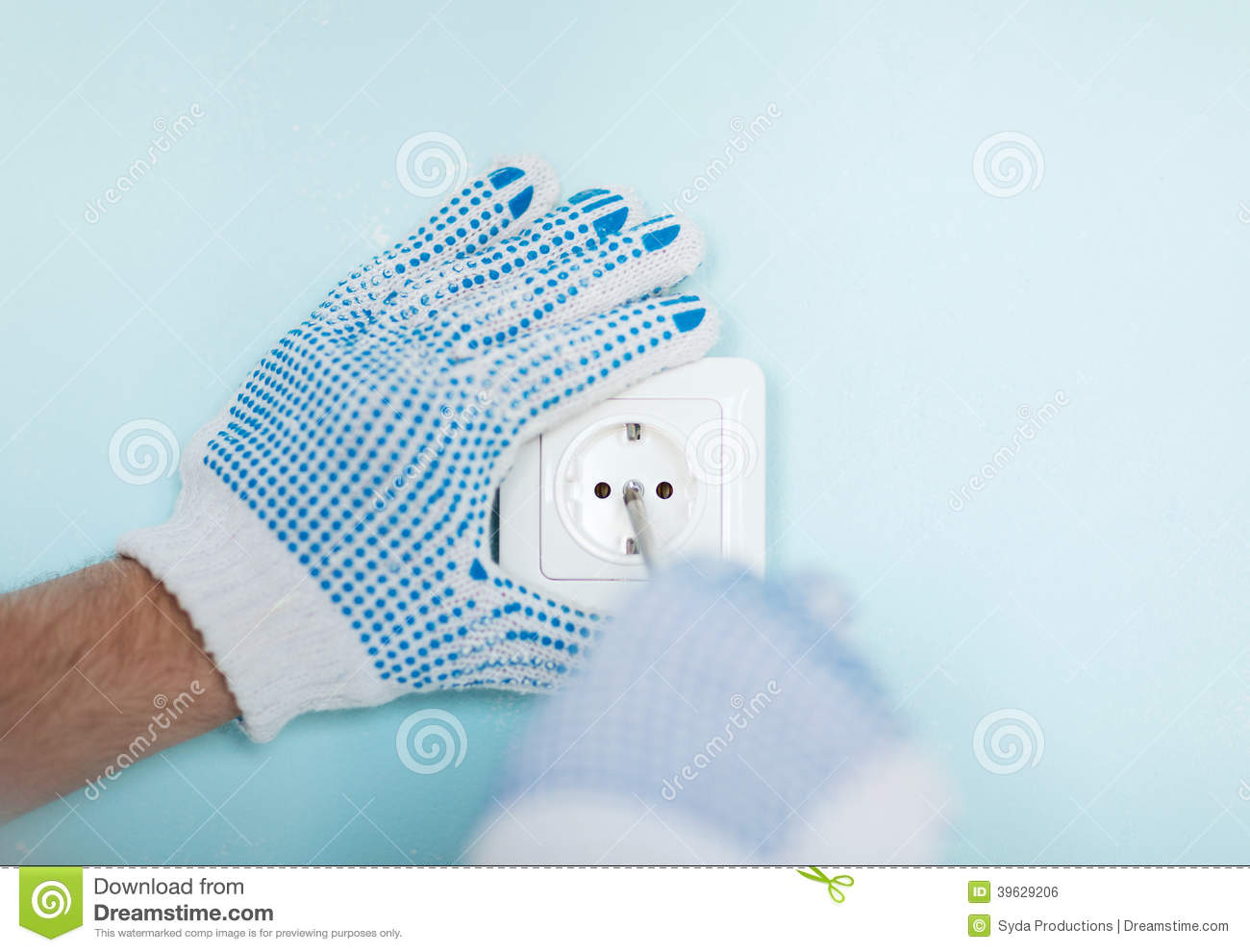 Close up of male in gloves installing new socket