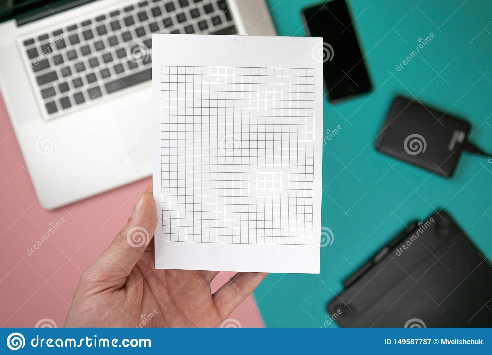 Close up male hands holding paper blank for design paper