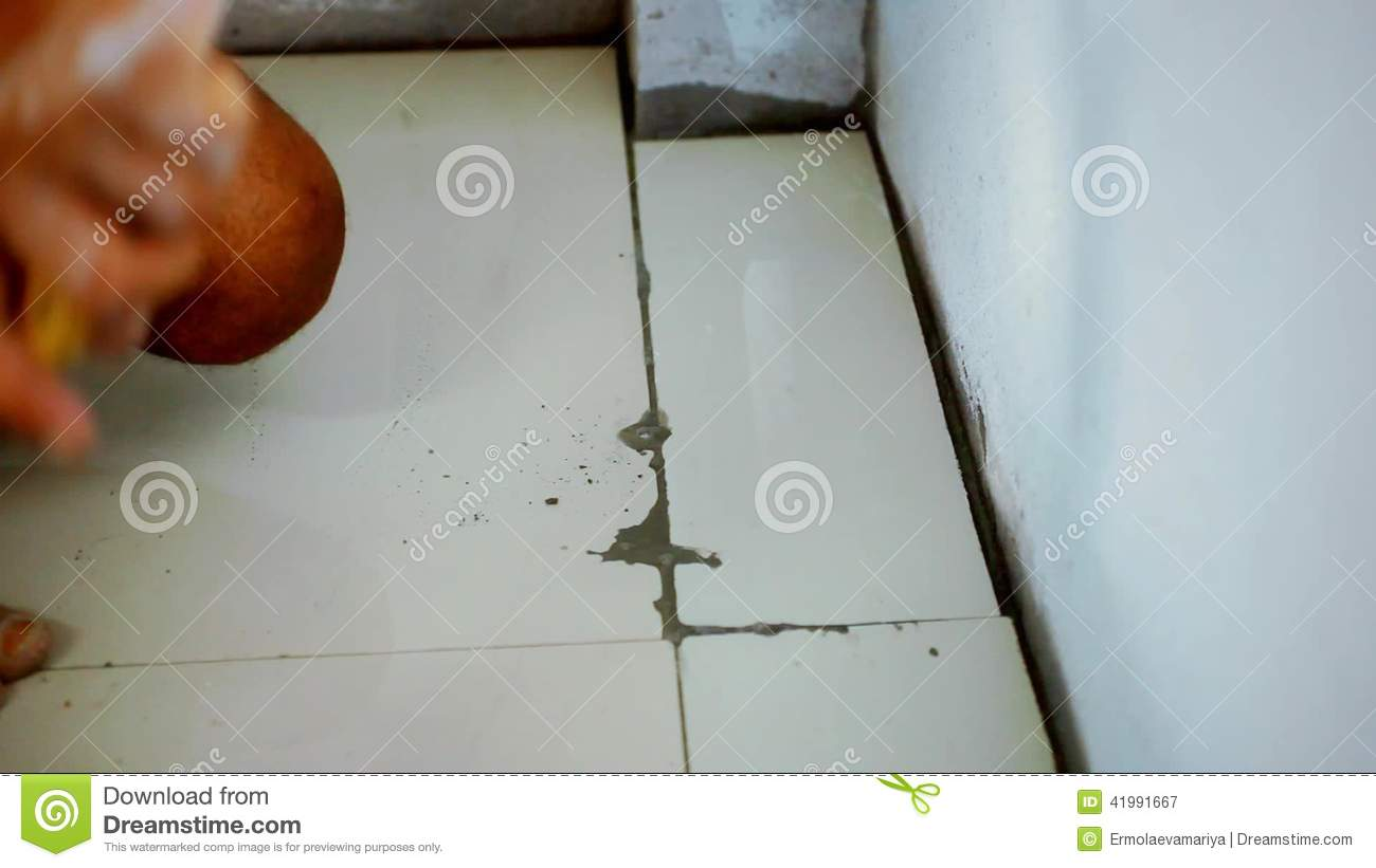 Laying floor tile video gallery tile flooring design ideas close up male hands laying ceramic floor tiles stock video close up male hands laying ceramic dailygadgetfo Gallery