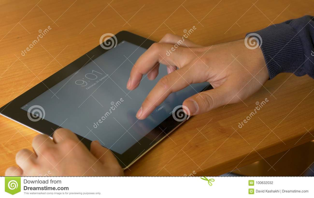 Close-up Of Male Hands Using Modern Digital Tablet And