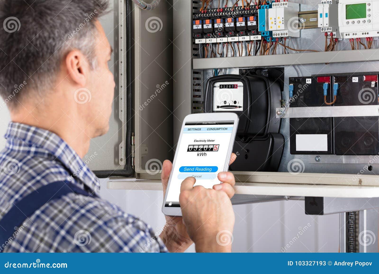 Technician Doing Meter Reading Using Mobilephone Stock Image
