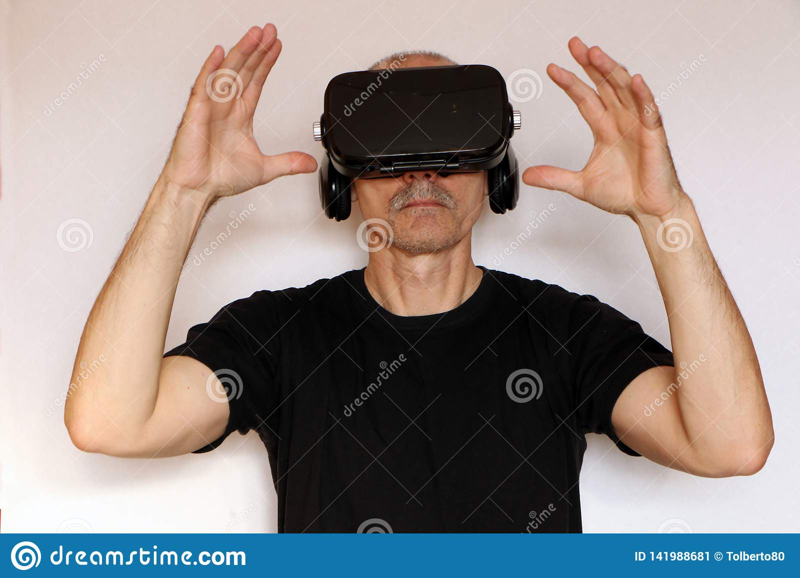 Close-up of a man in a black T-shirt with glasses of virtual reality