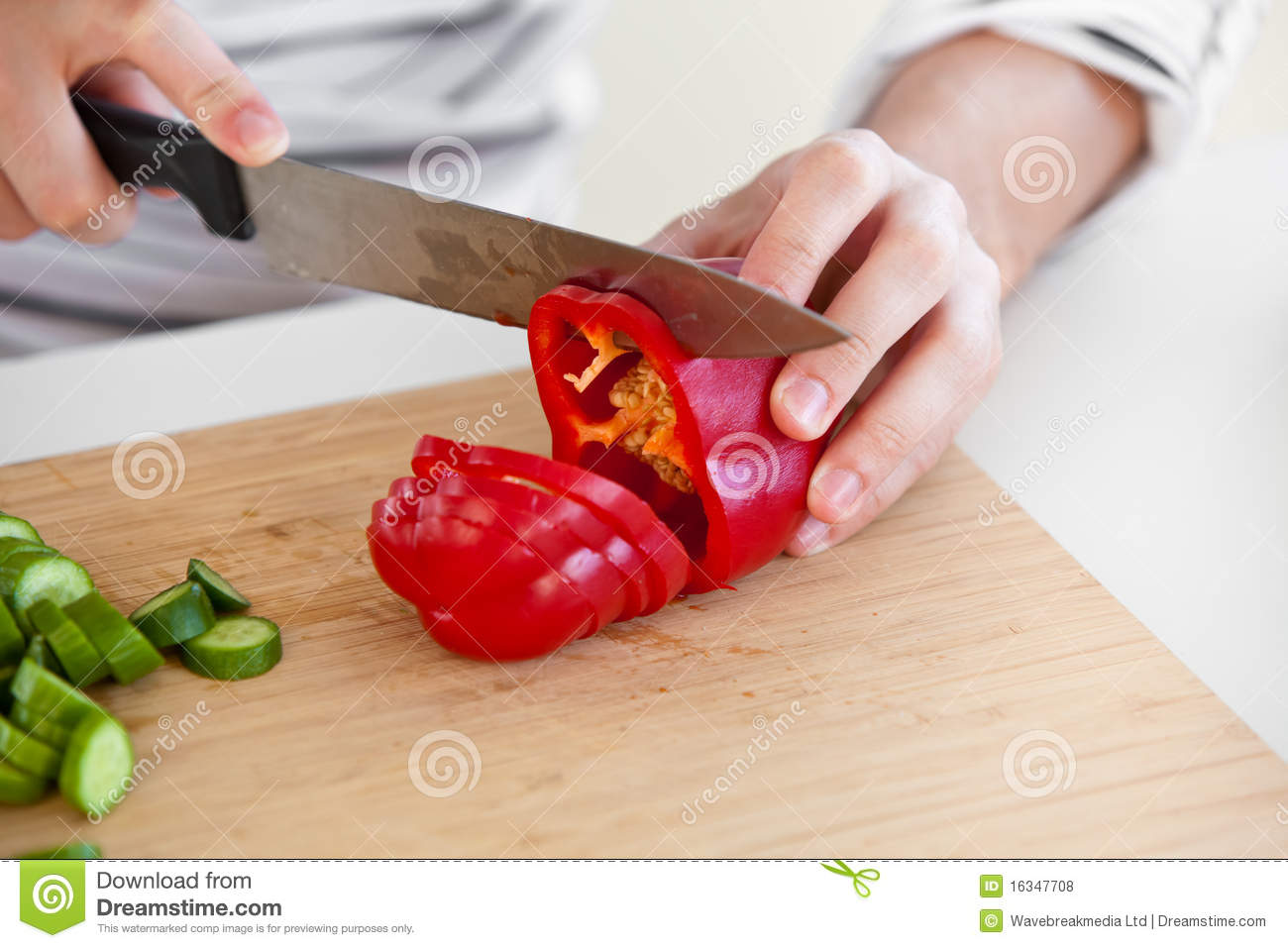 Close Up Of A Man Cutting Red Pepper In Kitchen Royalty