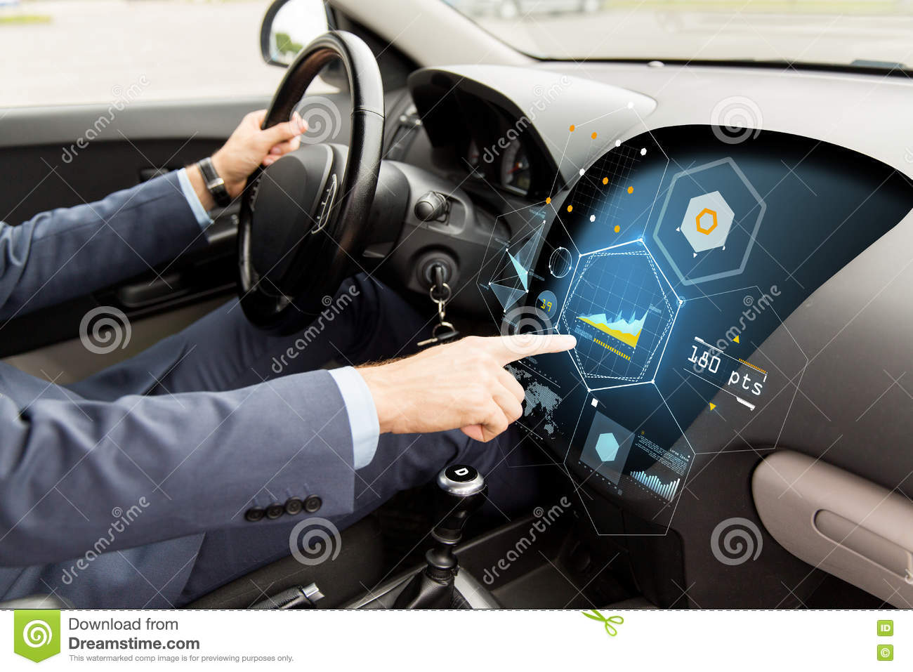 Close up of man driving car with diagram on screen