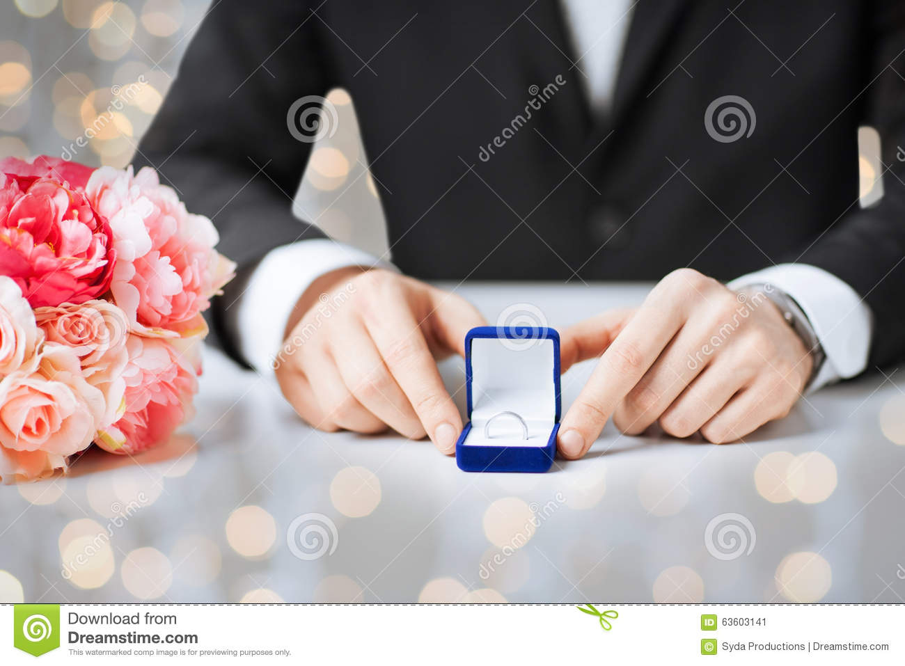 Close Up Of Man With Gift Box And Engagement Ring Stock Image