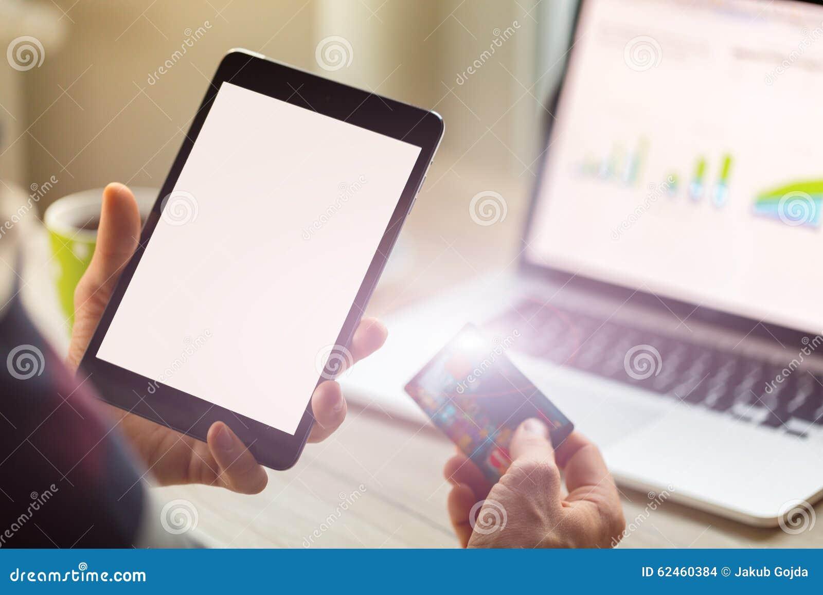 Close-up of man holding digital tablet