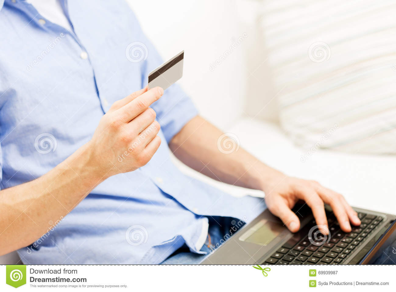 close up of man with laptop and credit card stock image image of lifestyle buyer 69939987. Black Bedroom Furniture Sets. Home Design Ideas