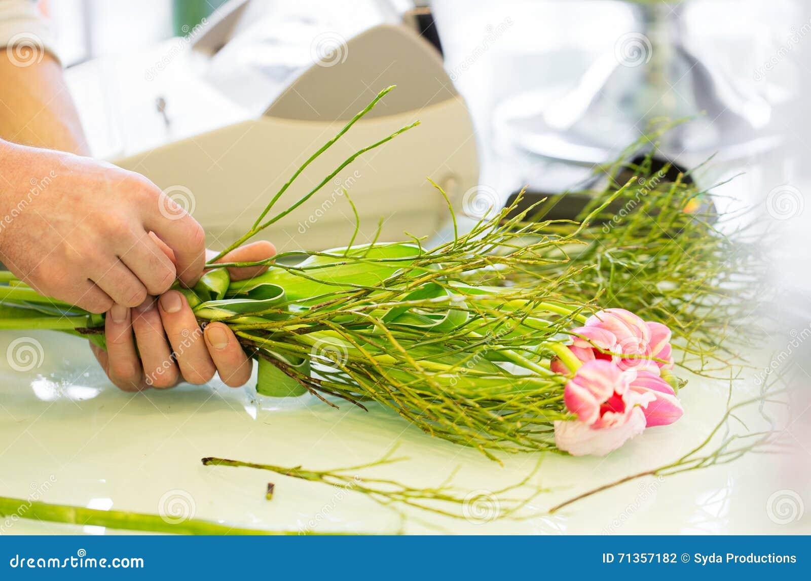 close up of man making bunch at flower shop stock photo. Black Bedroom Furniture Sets. Home Design Ideas
