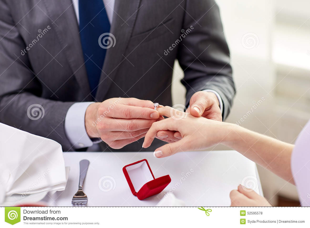 Close Up Of Man Putting Ring To His Fiance Finger Stock ...