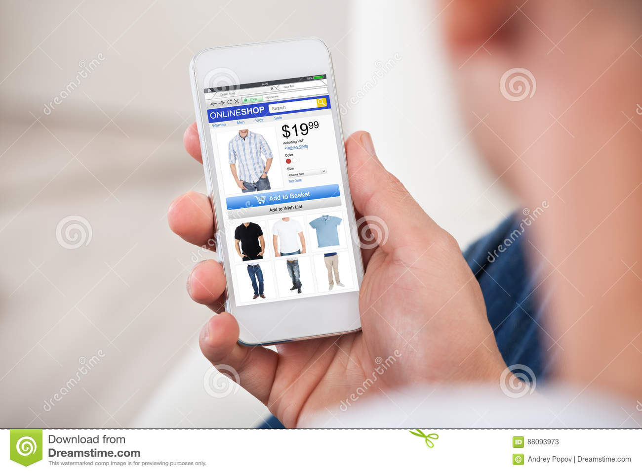 Close-up Of Man Shopping Online On Smartphone