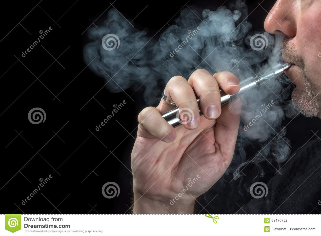 Close-up of a man vaping an electronic cigarette