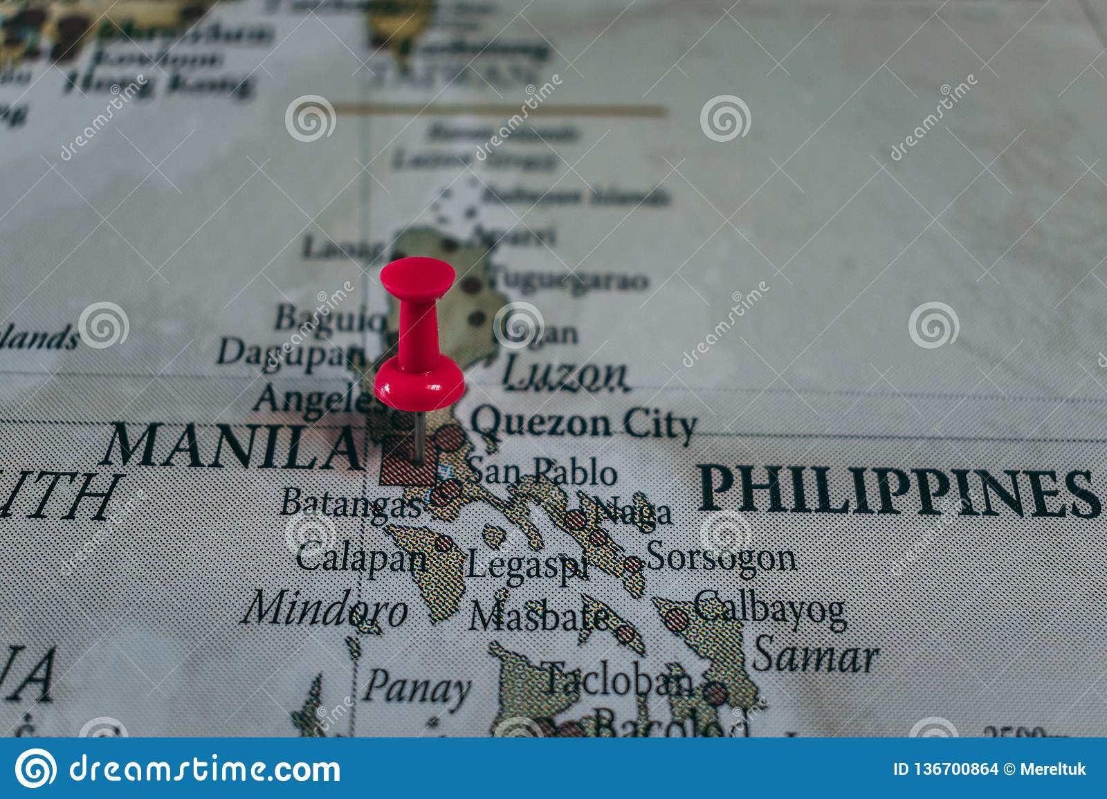 Close up of Manila pin pointed on the world map with a pink pushpin