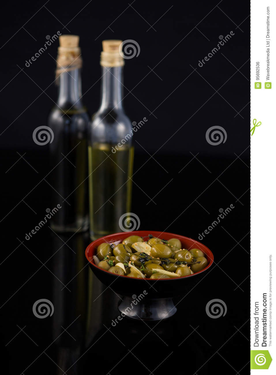 21ad19220f89 Close-up of marinated olives with olive oil and balsamic vinegar bottle