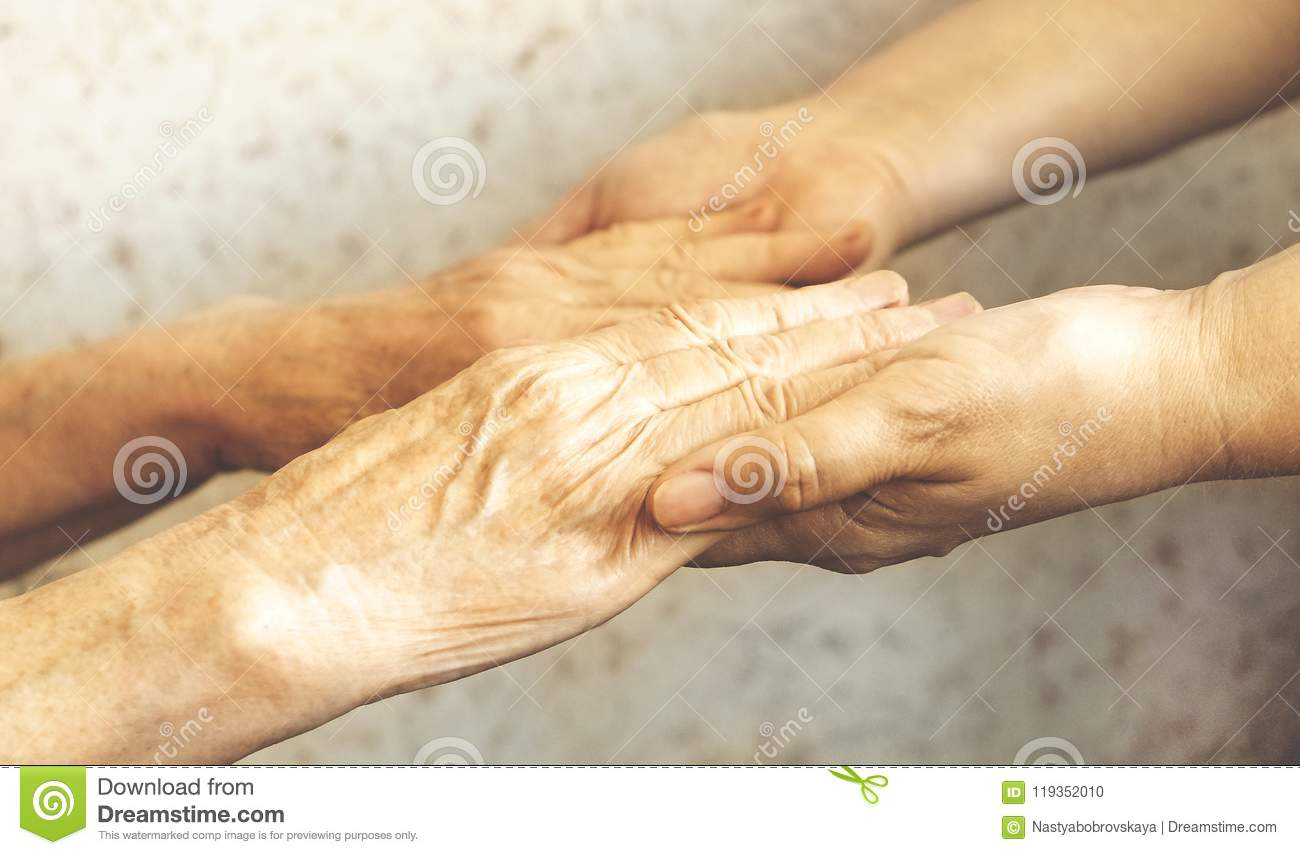 Close Up Of Mature Womans & Nurse Hands  Health Care Giving