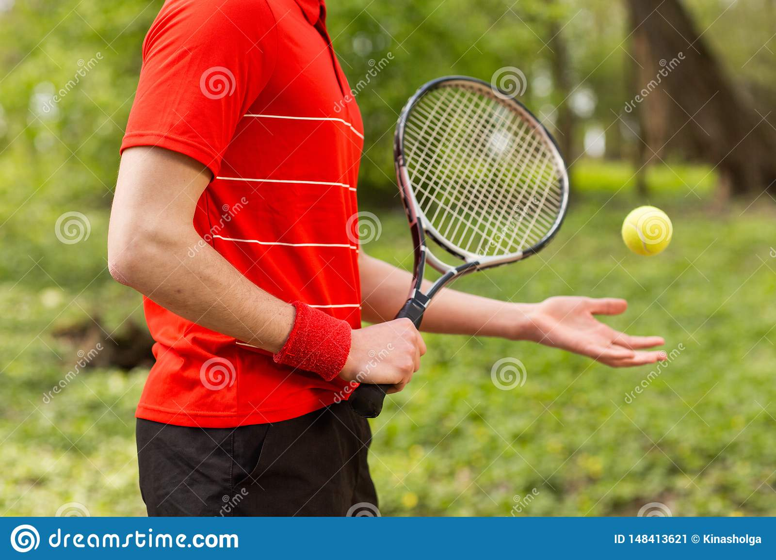 Close Up Of Men`s Hands Hold A Tennis Racket And Ball On The Green  Background. Sport Concept Stock Image - Image of ball, mens: 148413621
