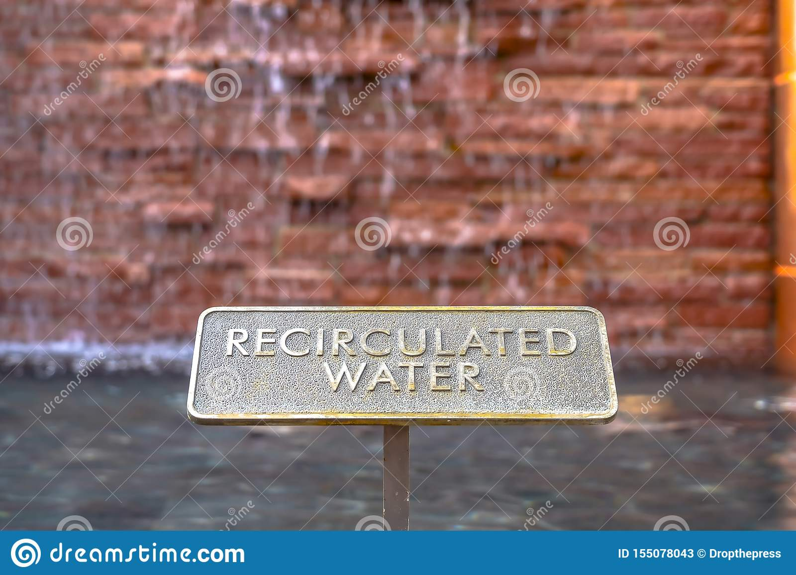 Close up of metal plate with words Recirculated Water embossed on surface