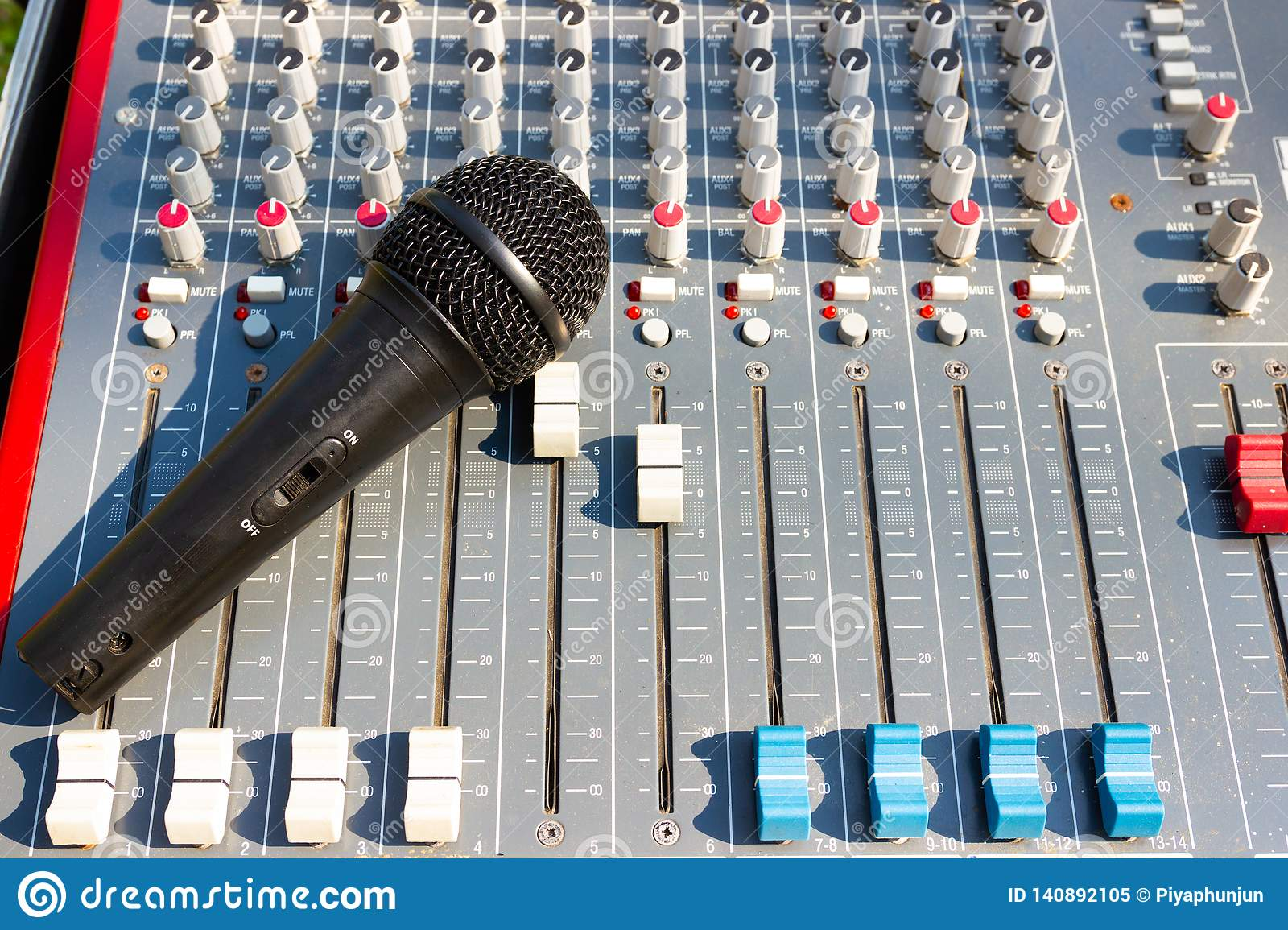 Microphone on Mixing Console of a big HiFi system, The audio equipment and control panel