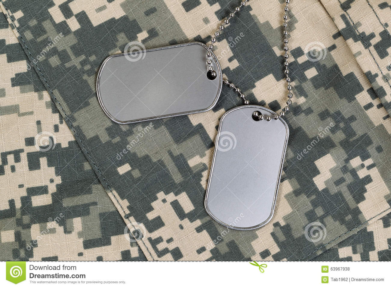 3088036cd352 Military identification tags, neck chain, and combat uniform top. Military  service concept.