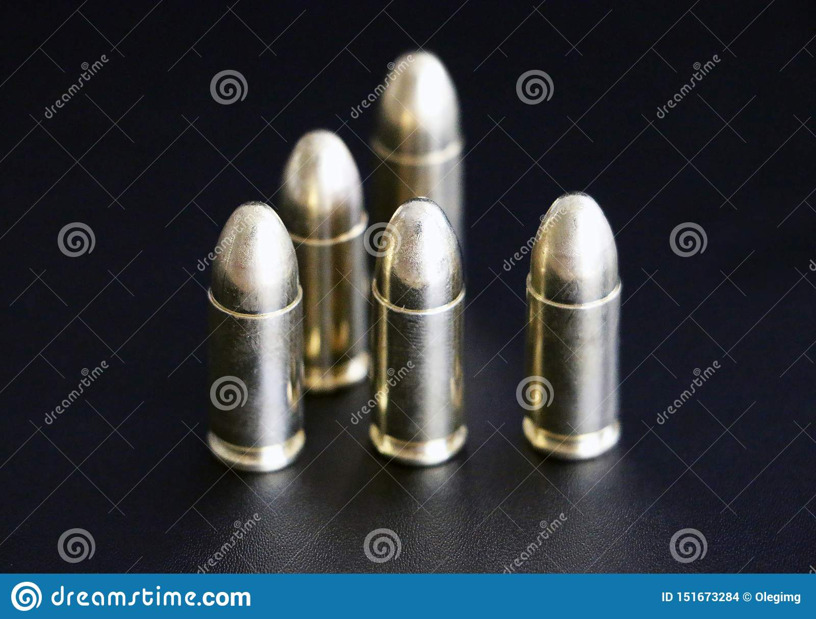 Close up of 9 mm golden pistol bullets ammo on background
