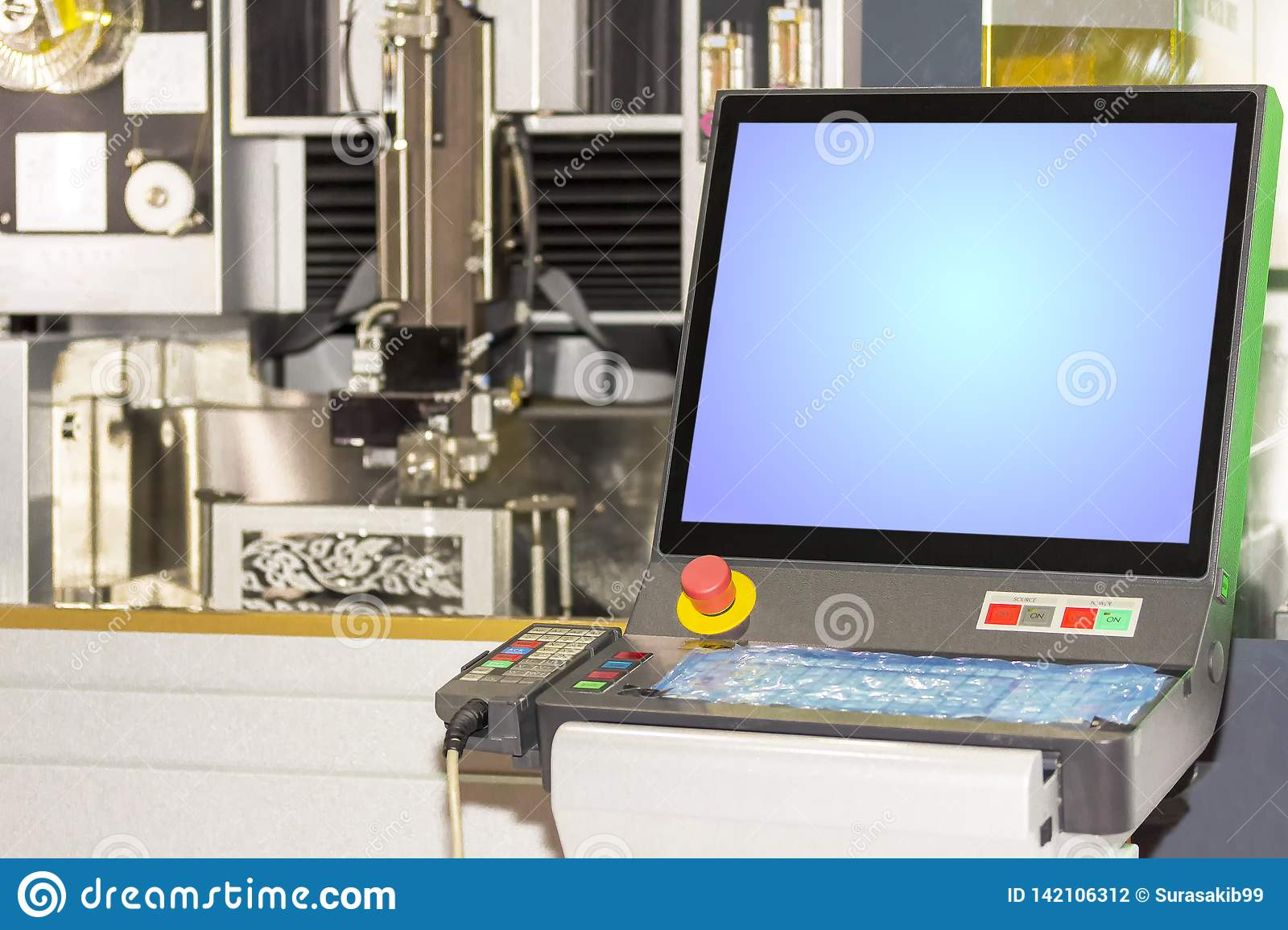 Close up monitor and control panel of high technology and precision mold cutting by cnc wire cut machine at factory