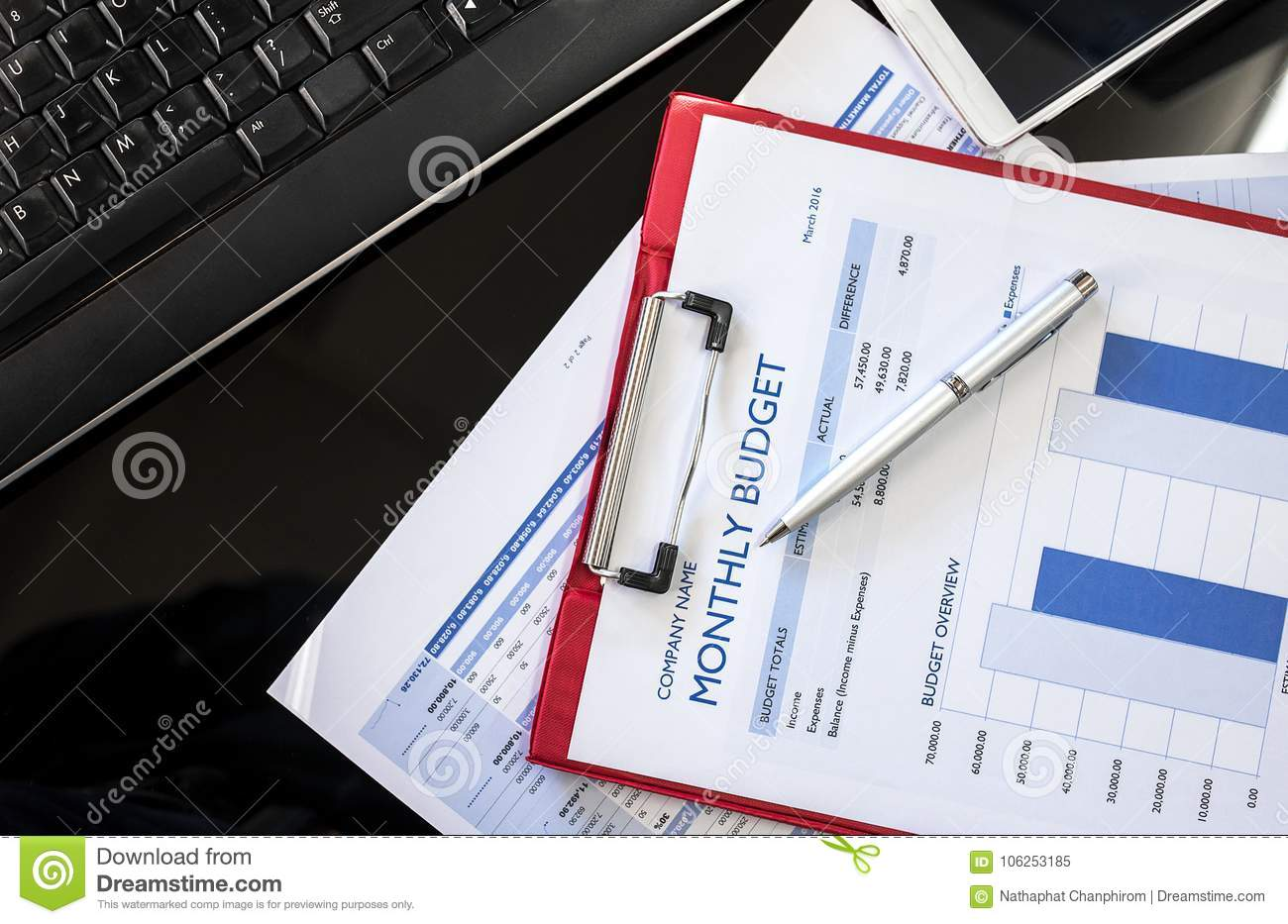 close up of monthly budget chart with red folder stock image image