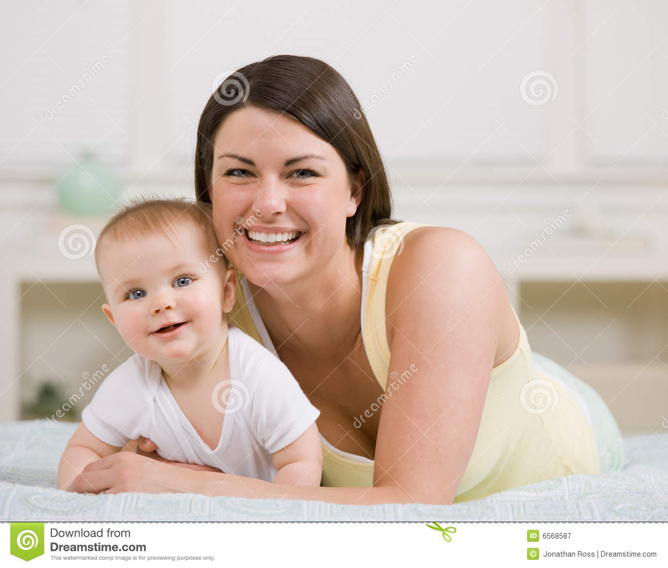 Close up of mother and baby posing at home