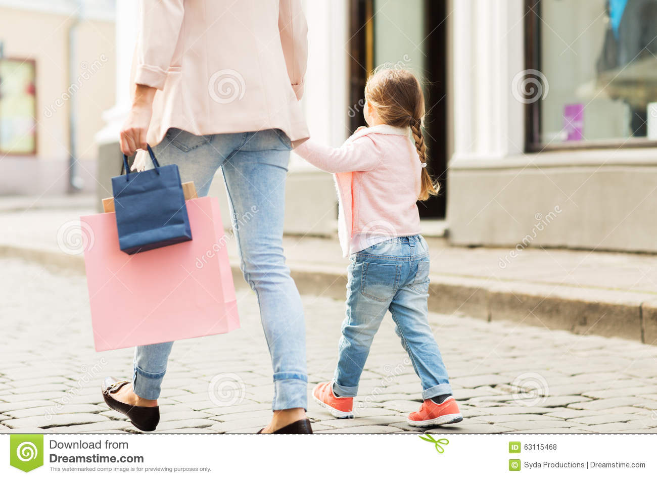 close up of mother and child shopping in city stock photo image 63115468. Black Bedroom Furniture Sets. Home Design Ideas