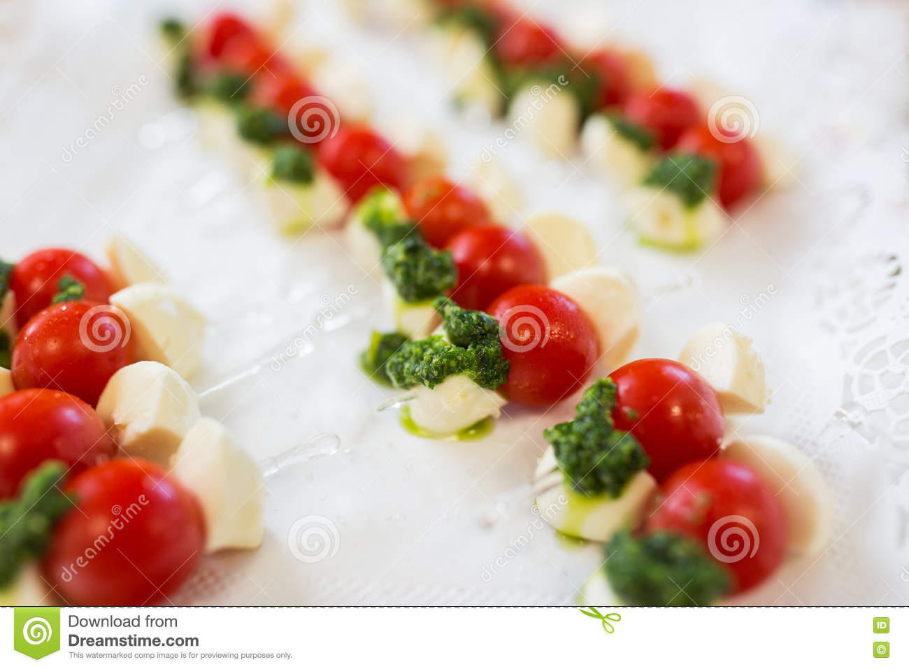 Close up of mozzarella and cherry tomato canape stock for Mozzarella canape